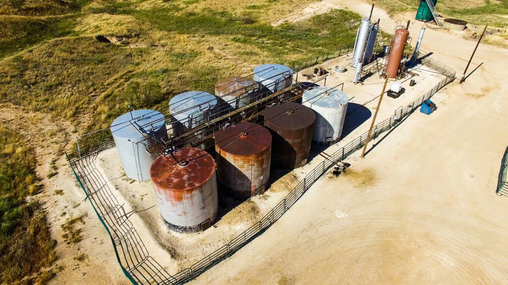 Rusted oil tanks in need of inspection.