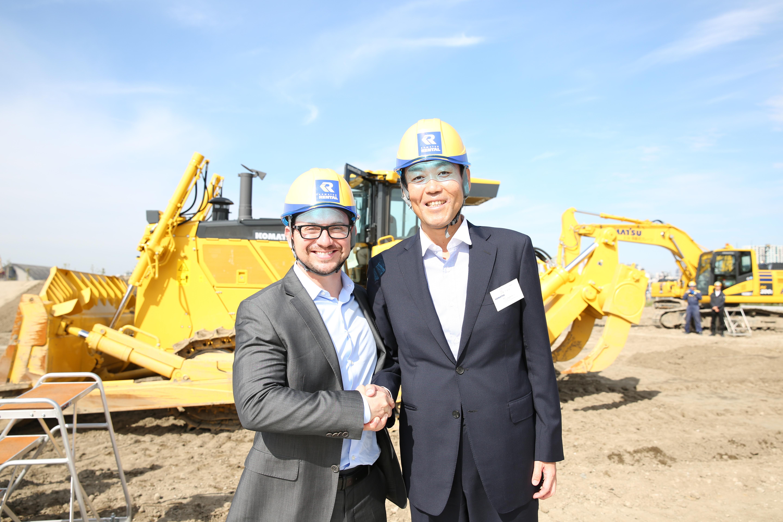 Chikashi Shike, President of Komatsu Smart Construction with Skycatch CEO, Christian Sanz at job-site in Japan